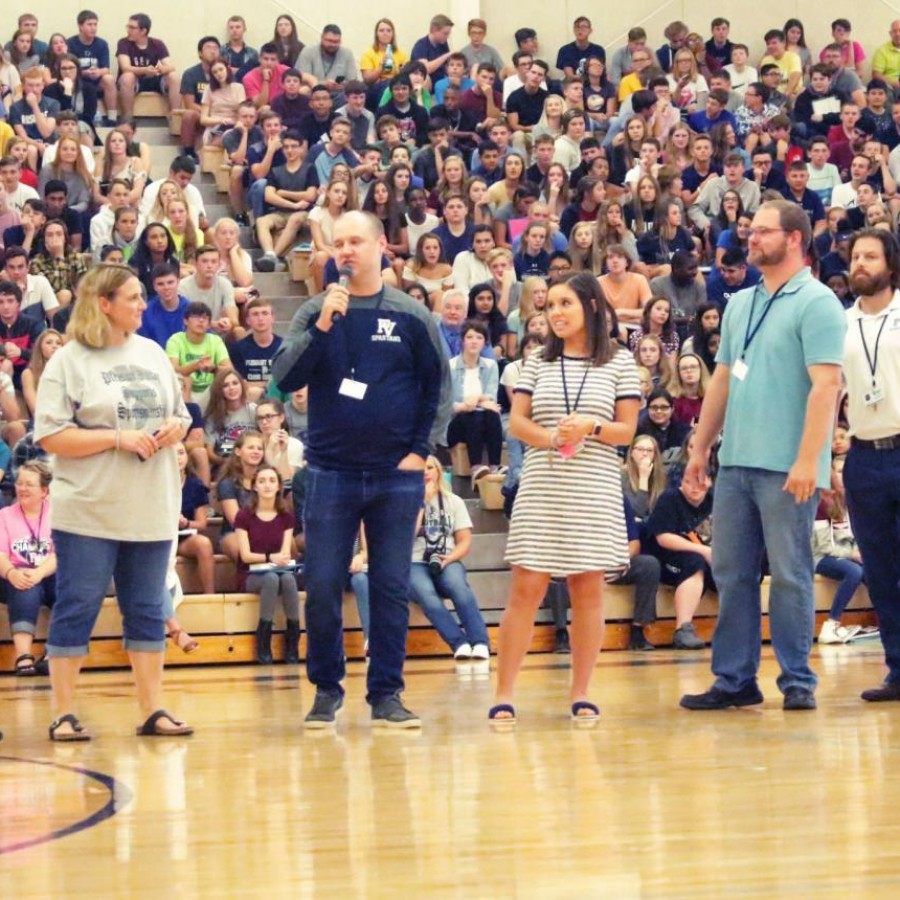 New teachers introducing themselves at the kickoff assembly.