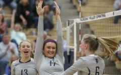 Senior Adrea Arthofer celebrates with her teammates during a game.