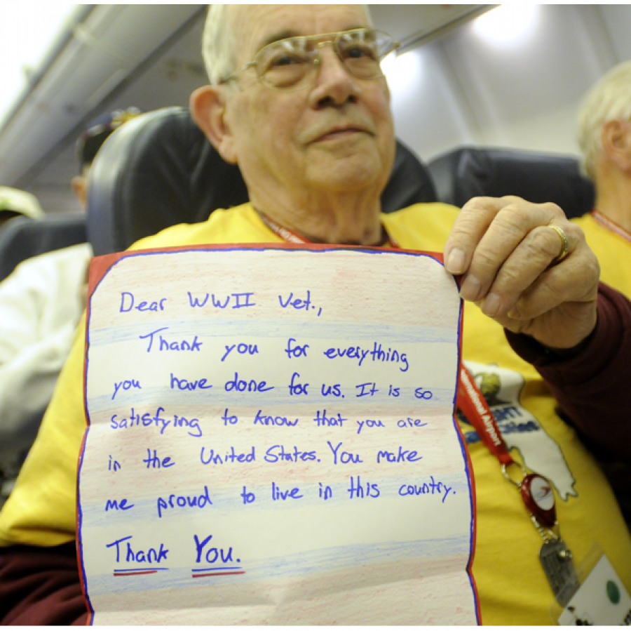 Veterans+sitting+aboard+the+honor+flight.