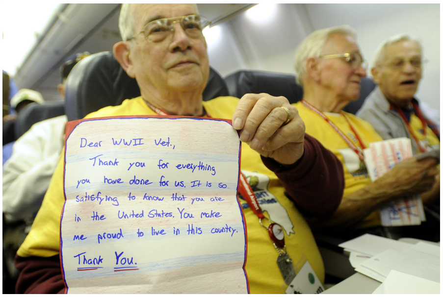 Veterans sitting aboard the honor flight.