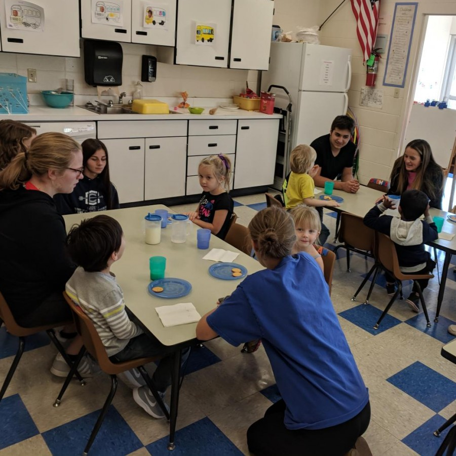 preschoolers interacting with high schoolers during the class/preschool offered at PVHS.