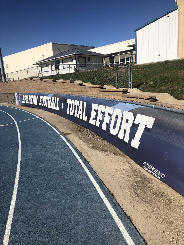 An inspiring banner in the football field.