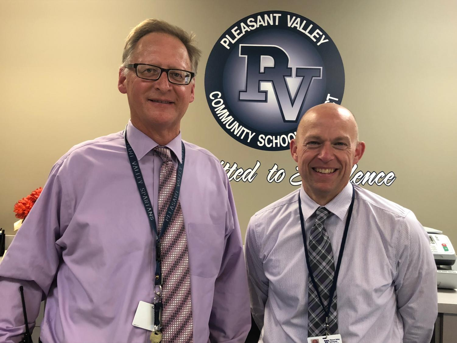 Superintendent Dr. Jim Spelhaug proudly stands with his appointed replacement, Brian Strusz.
