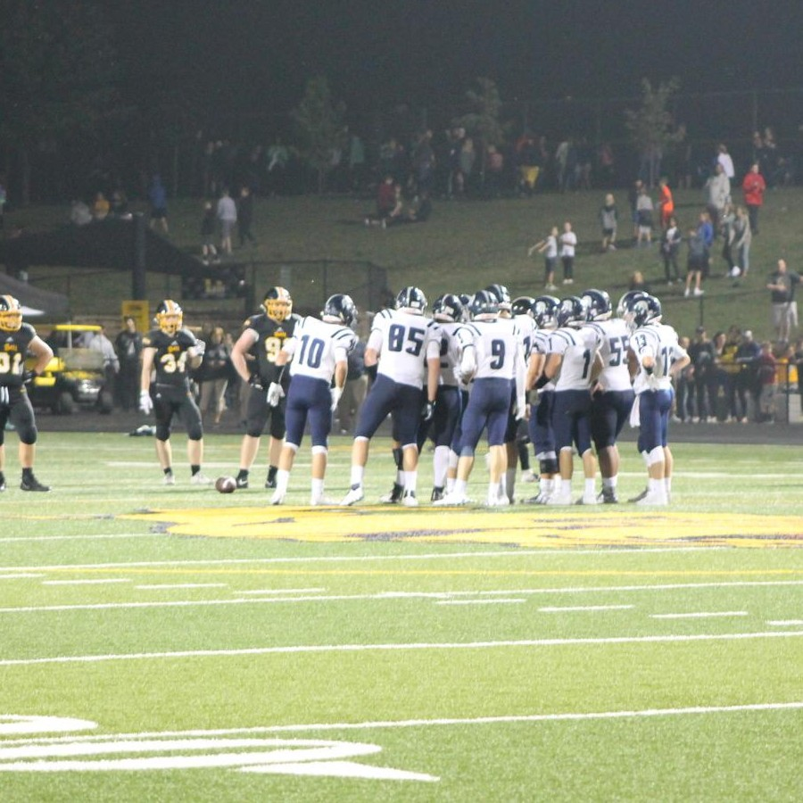Spartans+huddle+together+between+downs+while+competing+against+hometown+rival%2C+Bettendorf.