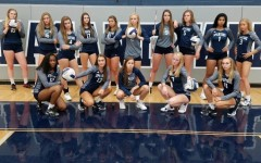 The girls volleyball team poses for a picture