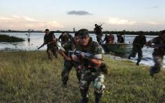 Marines running an assault