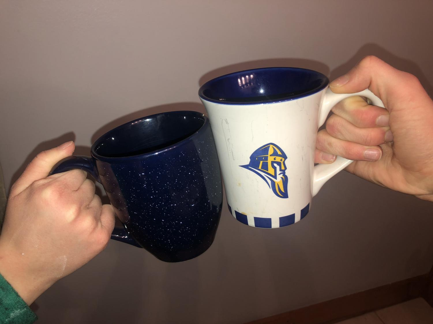 Coffee mugs clink in the commons.