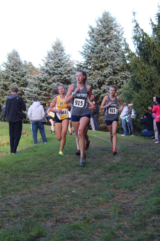 Riley ran during a cross country meet at Clinton High School.