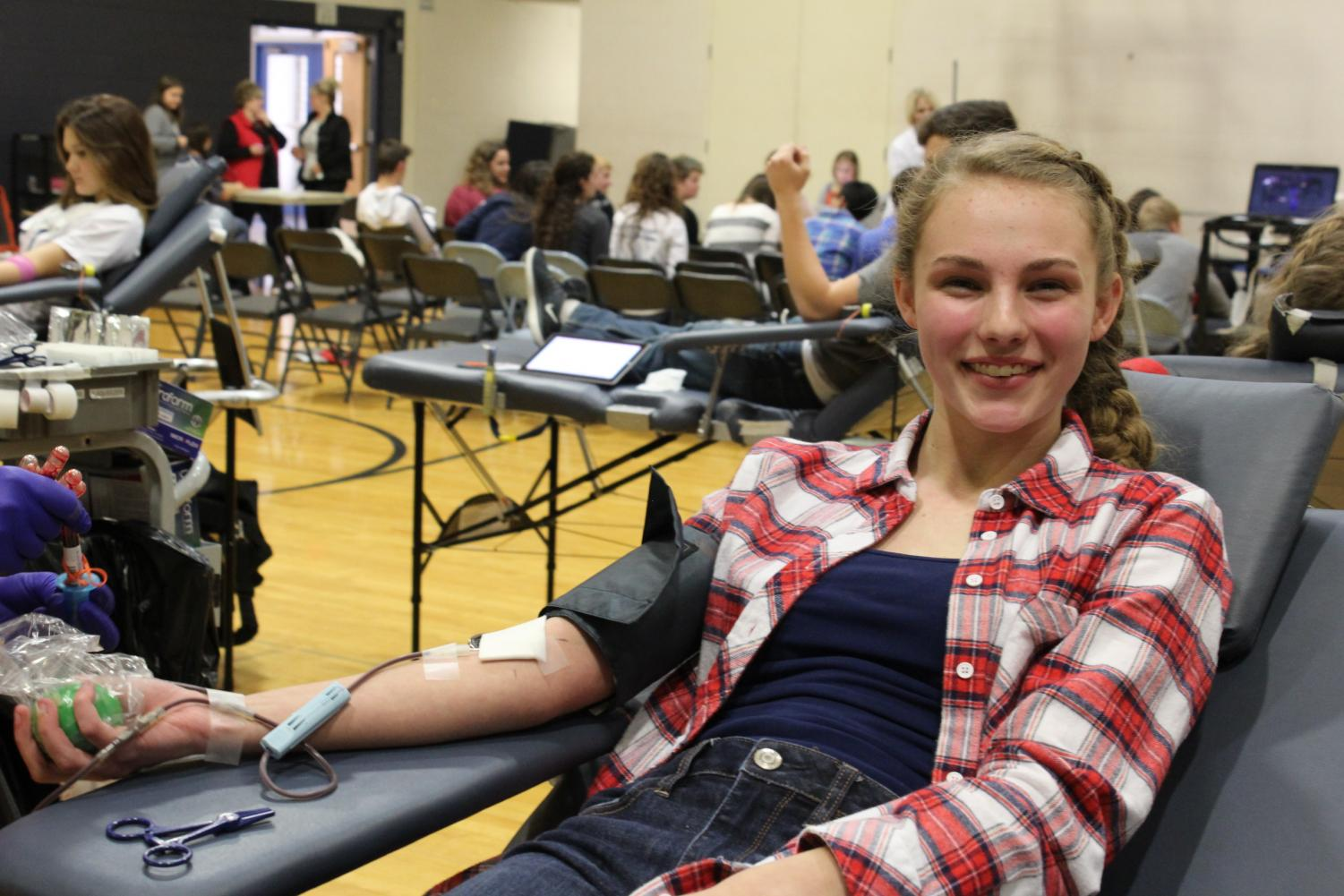 Current senior Alyssa Paulson donating at last years Spartan Assembly blood drive.