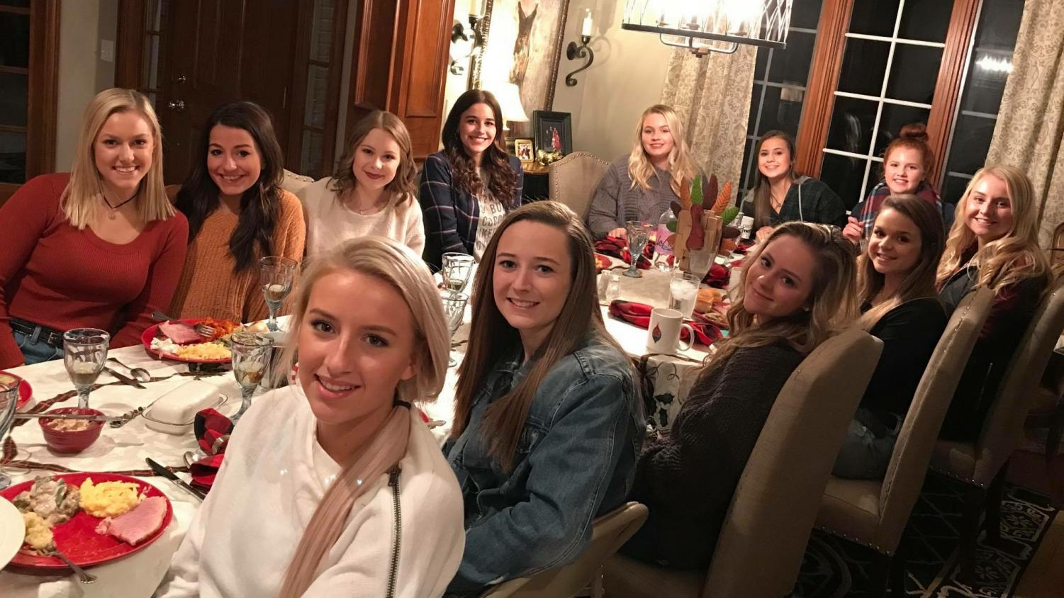 Students sit down to celebrate Friendsgiving with food they made for each other.