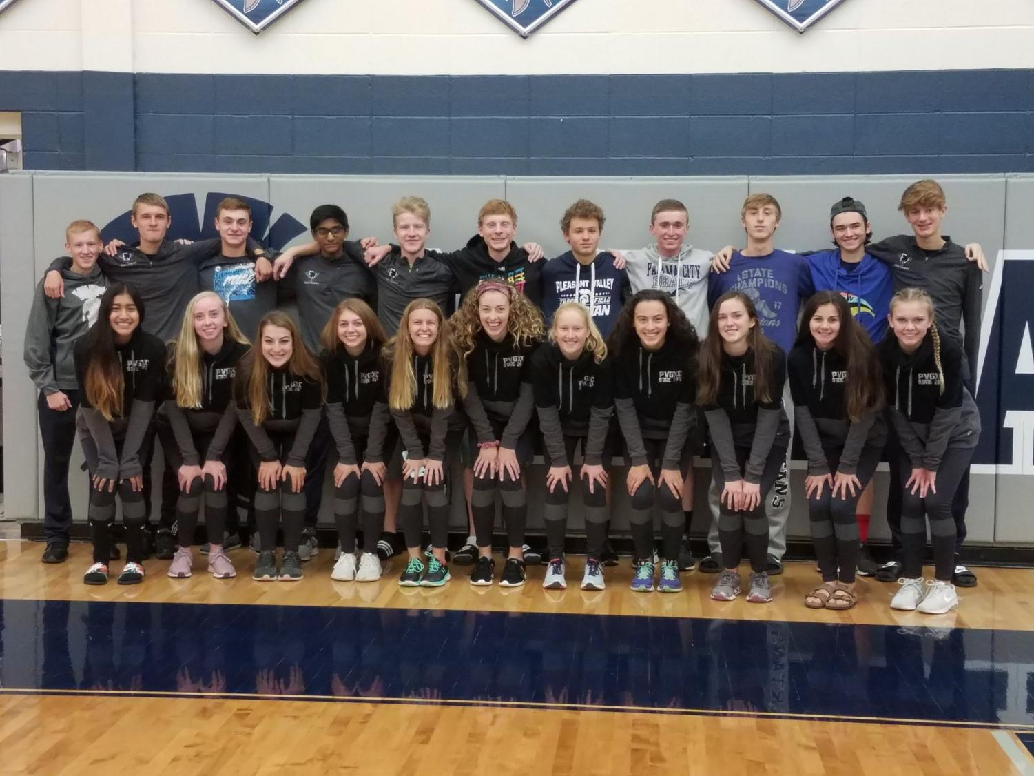 The Cross Country Varsity teams pose together for a picture at their send off before heading off to the state meet.