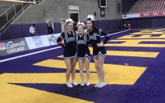 Varsity cheerleaders representing the Spartans at the Dome