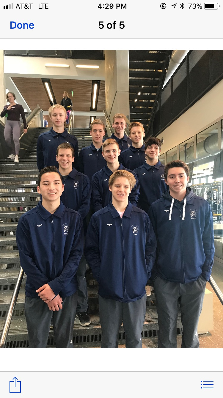 The boys varsity swim team poses for a picture after their state championship meet in Iowa City (Clark is  in the second row in the center)