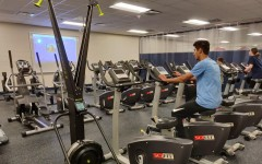 Students use the new fitness area facilities.