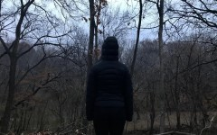 A student stands in front of a dark winter landscape