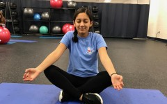 Junior Aabha Joshi meditating to relieve anxious feelings before her next class.