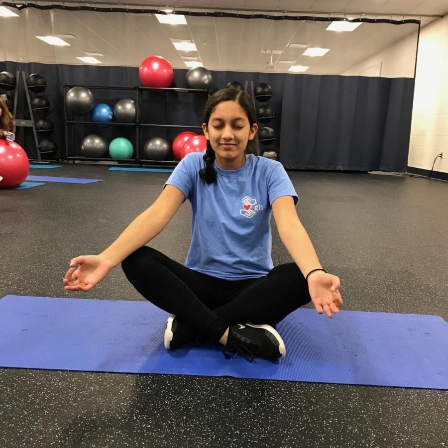 Junior Aabha Joshi meditating to relieve anxious feelings before her next class.