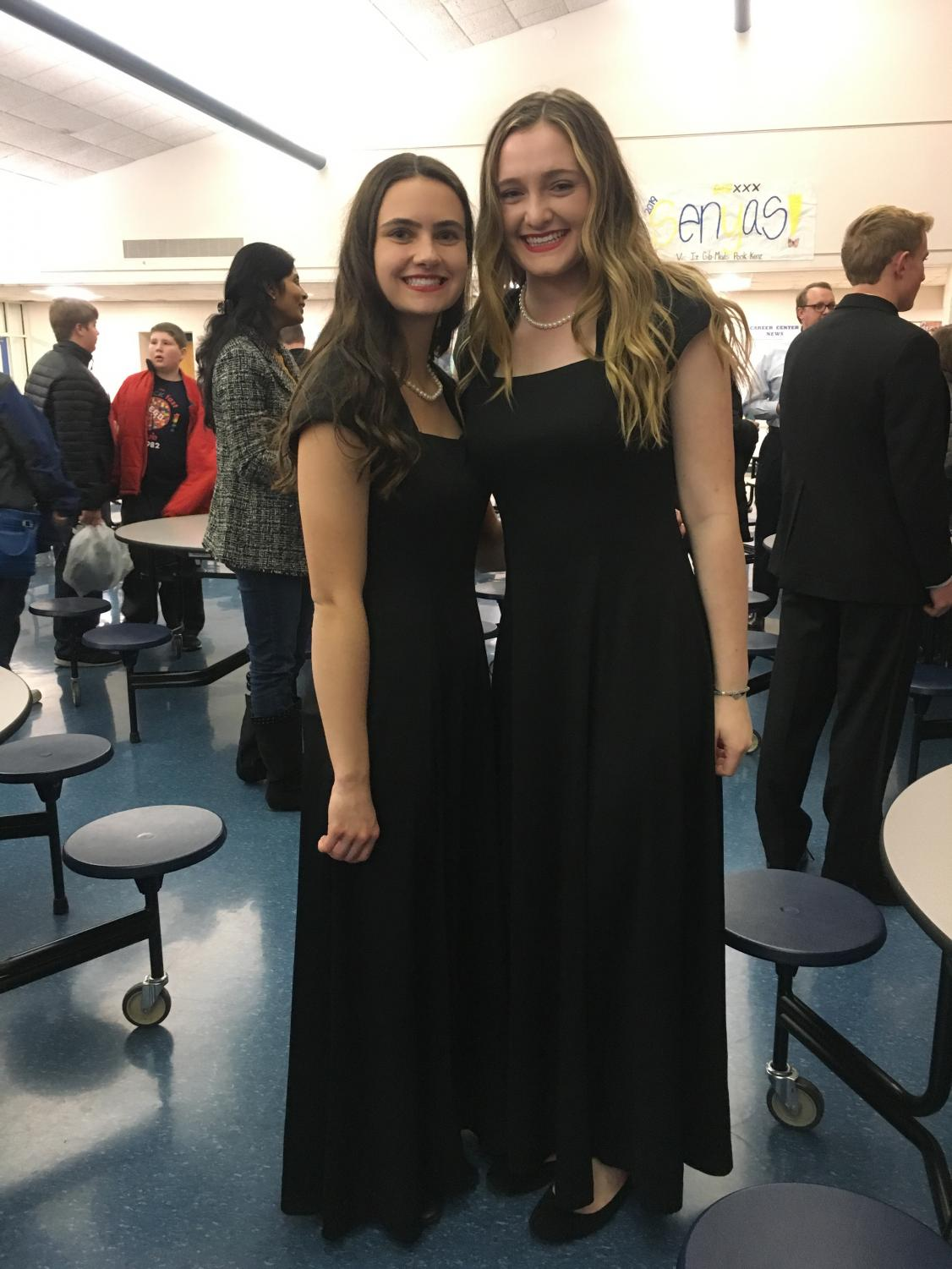 Seniors Ashlee Kwak and Ruth Davidson after the holiday choir concert on Monday, December 17