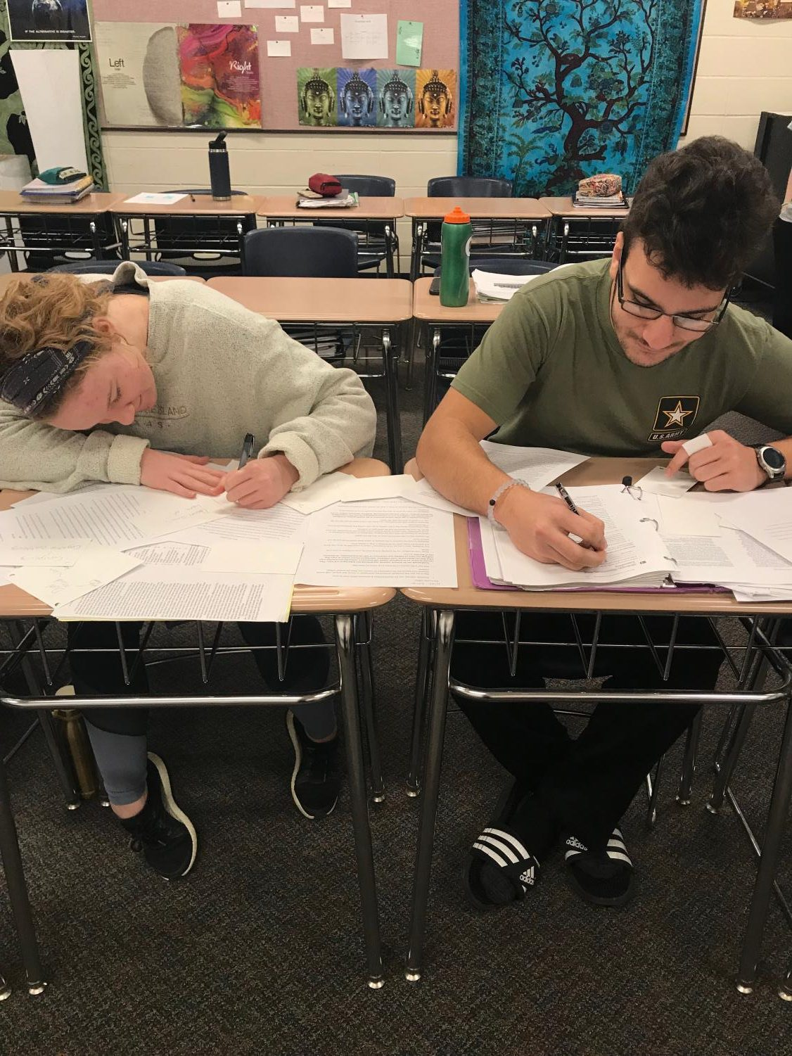 Gui Pinho and Libby Staver, seniors, working on homework for their dual credit psychology class.