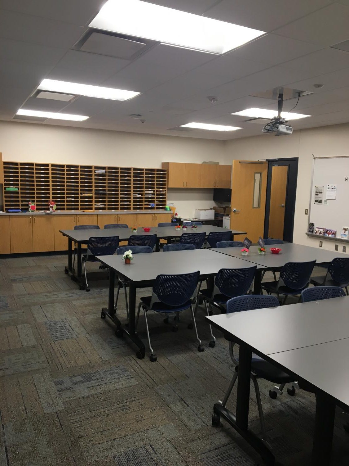The teachers lounge is filled with movable tables and chairs so the room can be rearranged easily.