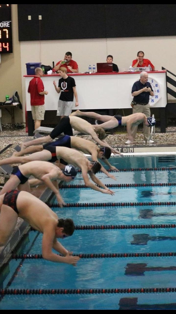 Senior Jacob McCredie (far back), Senior Alex Valenca, and Sophomore Tyler Sutton swim the 100 breastroke and the clinton dual meet last year.