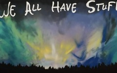A mural painted of a night sky saying,