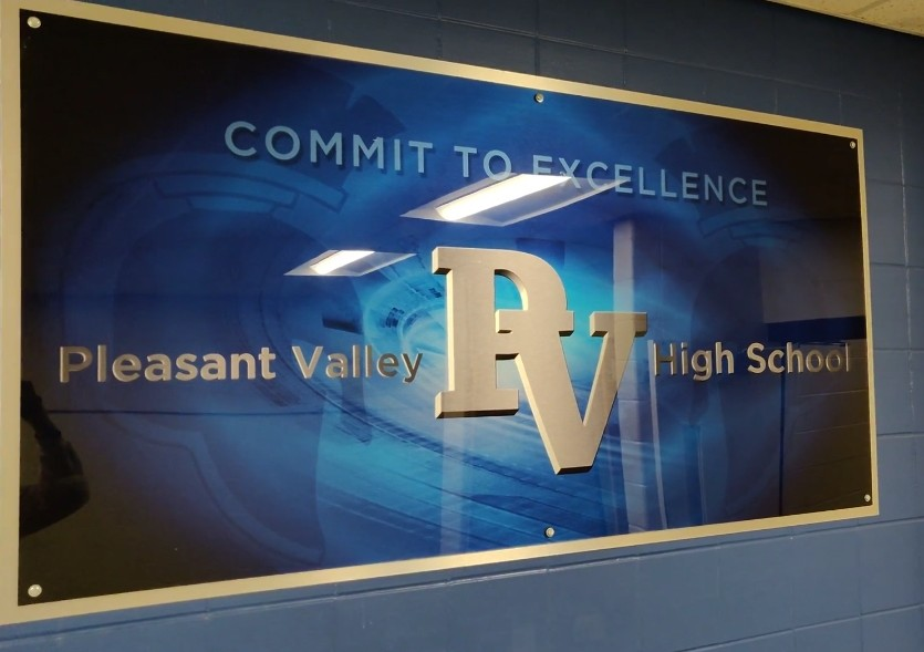 PV's motto of committed to excellence.