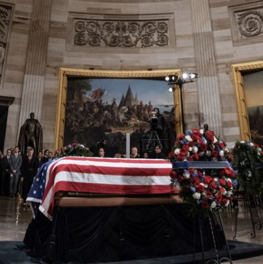 Americans say goodbye to George H.W. Bush for one last time.
