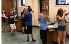 Students at the junior high using virtual reality to learn in the classroom.