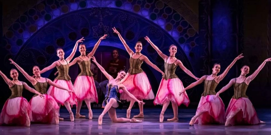 Pleasant+Valley+students+Haley+Zellmer%2C+Sarah+McVey+and+Daniela+Rybarczyk+perform+with+area+professional+dancers+in+the+Ballet+Quad+City+production+of+%22The+Nutcracker.%22