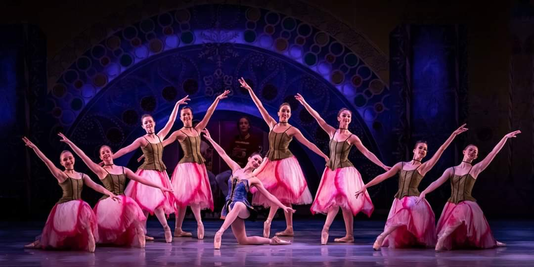 Pleasant Valley students Haley Zellmer, Sarah McVey and Daniela Rybarczyk perform with area professional dancers in the Ballet Quad City production of