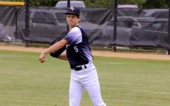 Senior Kyle McDermott throwing a baseball during his junior season.