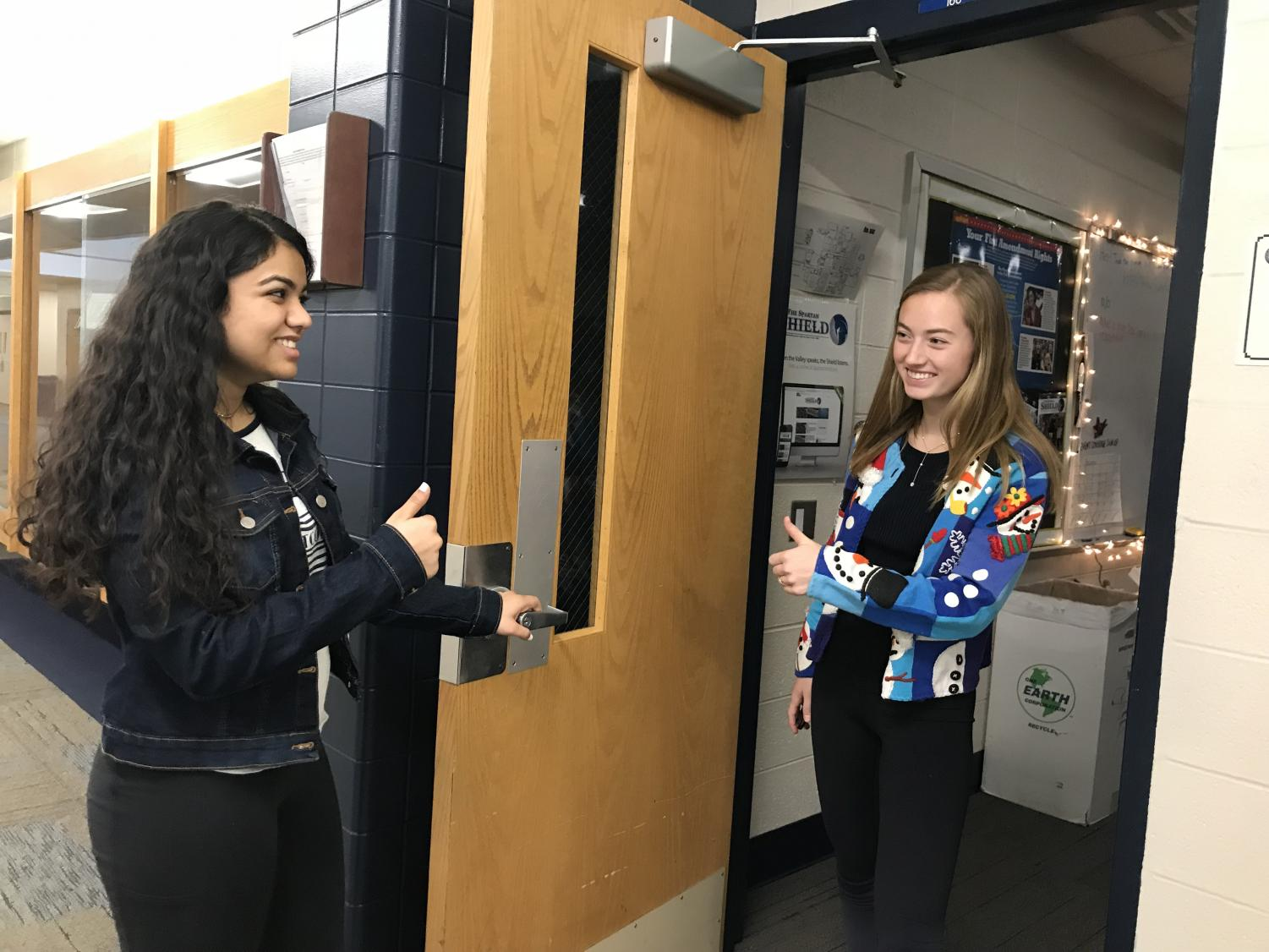 Seniors Divya Vashisht and Christy Bishop embrace the Christmas season and represent the pay-it-forward movement
