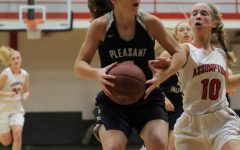 Senior, Carli Spelhaug, starts the game with a layup for two more points for the Spartans.