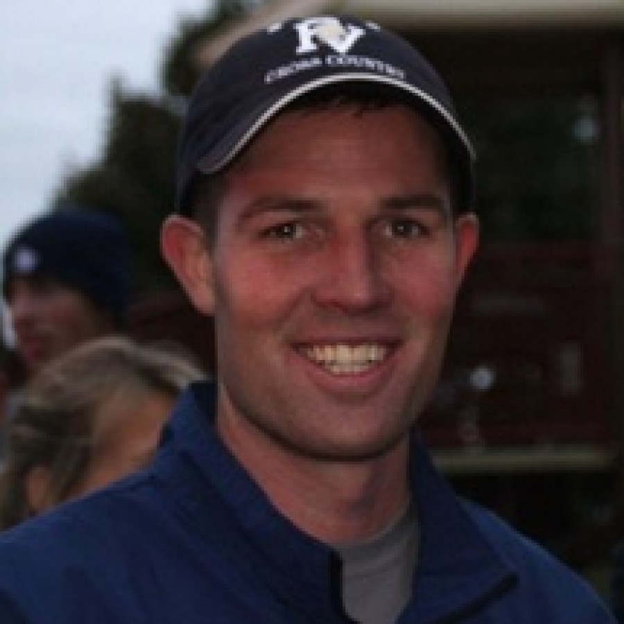 Track and Field head coach Erik Belby