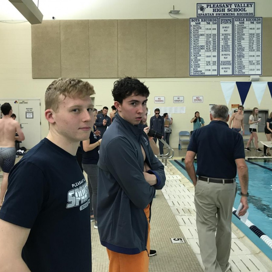 Senior+captains+Jacob+Mccredie+and+Kevin+Burke+catch+the+camera+as+they+watch+their+teammates+swim+from+the+sidelines.+The+boys%27+swim+team+is+in+the+middle+of+season+currently+and+can+be+found+racing+other+schools+in+the+swimming+pool+at+Pleasant+Valley+High+School
