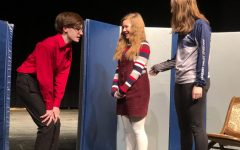(From left) Sophomore Logan Croll, freshman Caroline Sierk and freshman Grace Engstrom play three of the four children in