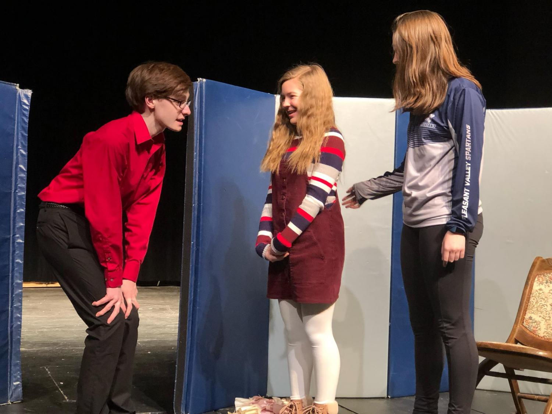 (From left) Sophomore Logan Croll, freshman Caroline Sierk and freshman Grace Engstrom play three of the four children in