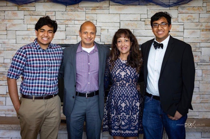 Pictured (left to right) Rishi Wagle, Nikhil Wagle, Archana Wagle, Keshav Wagle.   Wagle poses for a photo with his wife and two sons (who are both PV alumni).