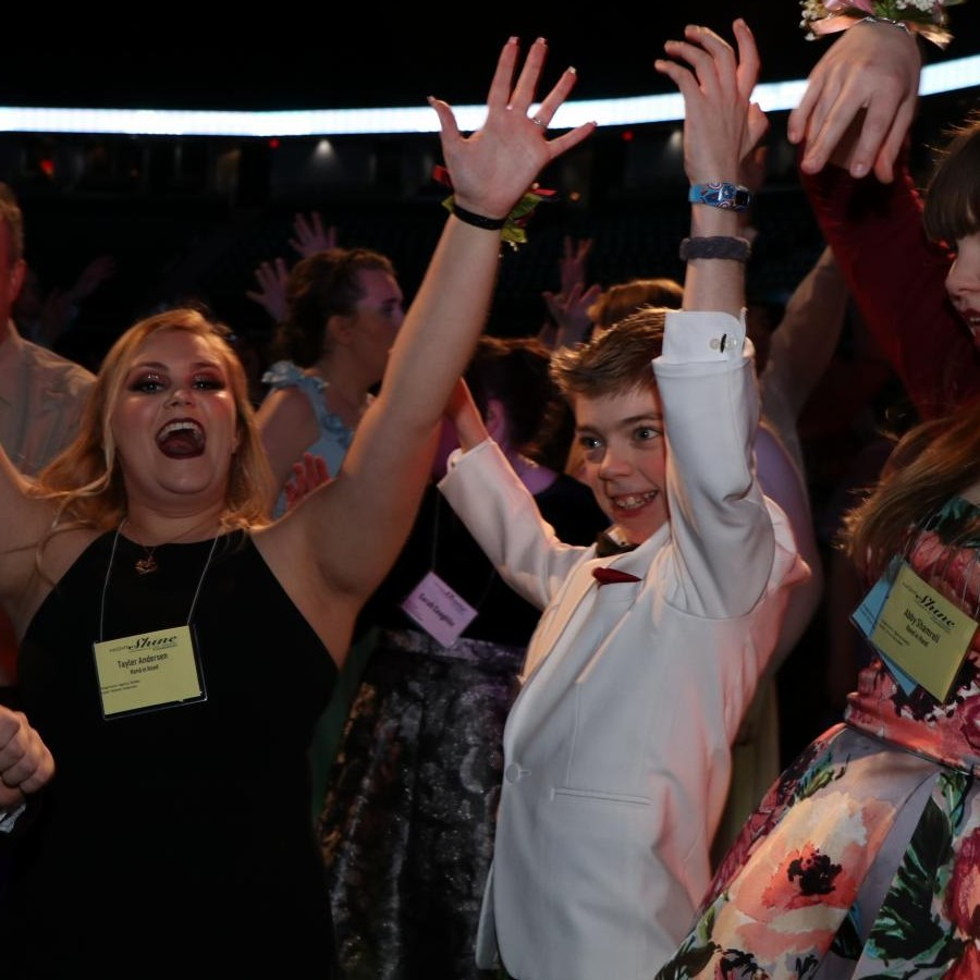 Pleasant Valley student Ethan Bond, 14, enjoys dancing the night away at the Quad Cities Night to Shine at the Tax Slayer Center in Moline on Feb. 9.