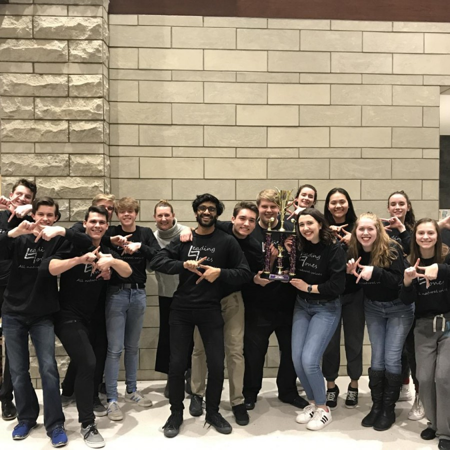 Pleasant Valley jazz choir, Leading Tones, with their first place trophy at the West Liberty Jazz Festival.