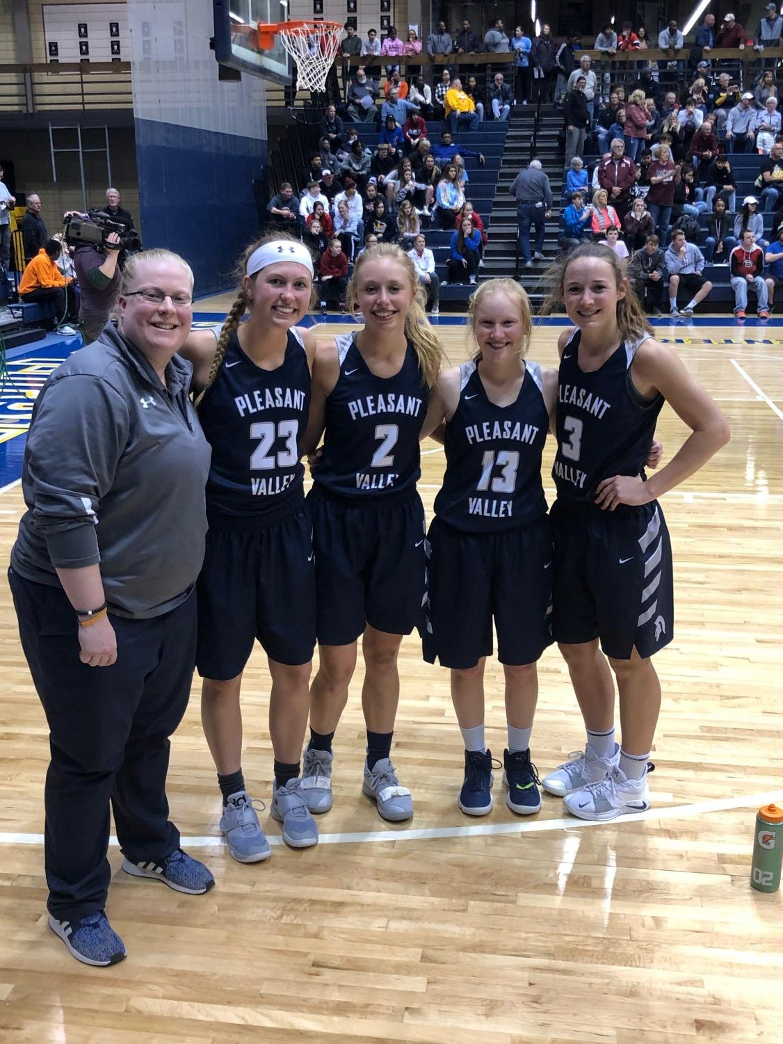 Coach Jennifer Goetz, Macy Beinborn, Adrea Arthofer, Mallory Lafever and Carli Spelhaug together after an impressive showing at the Iowa / Illinois Senior All Star game.