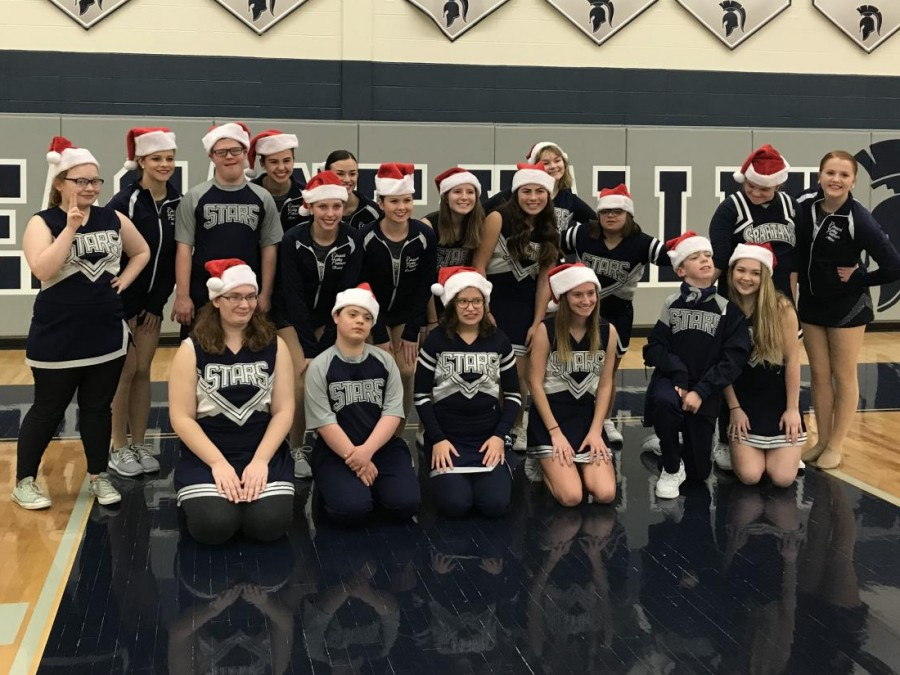 The Shining Stars dance team are all smiles after performing a dance during halftime of the jv boys basketball game.