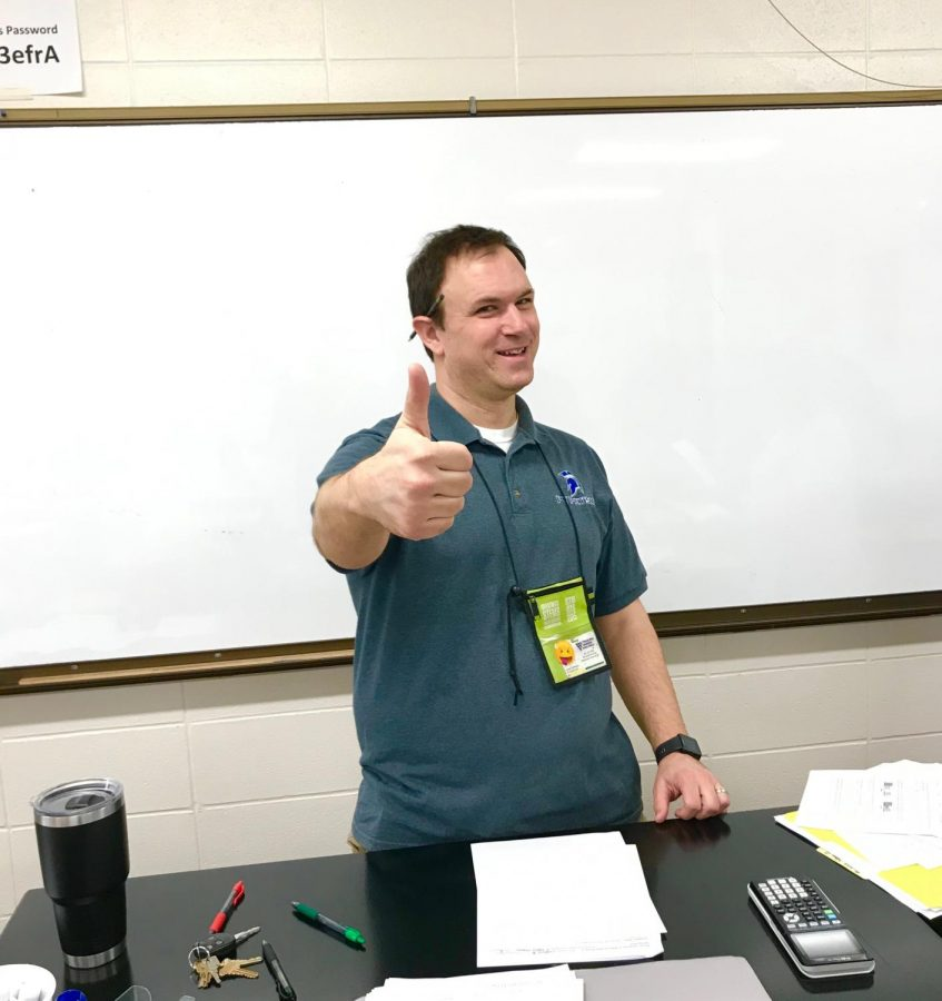 Mr.+Hoffman+giving+a+thumbs+up+after+handing+out+his+midterm+final.+