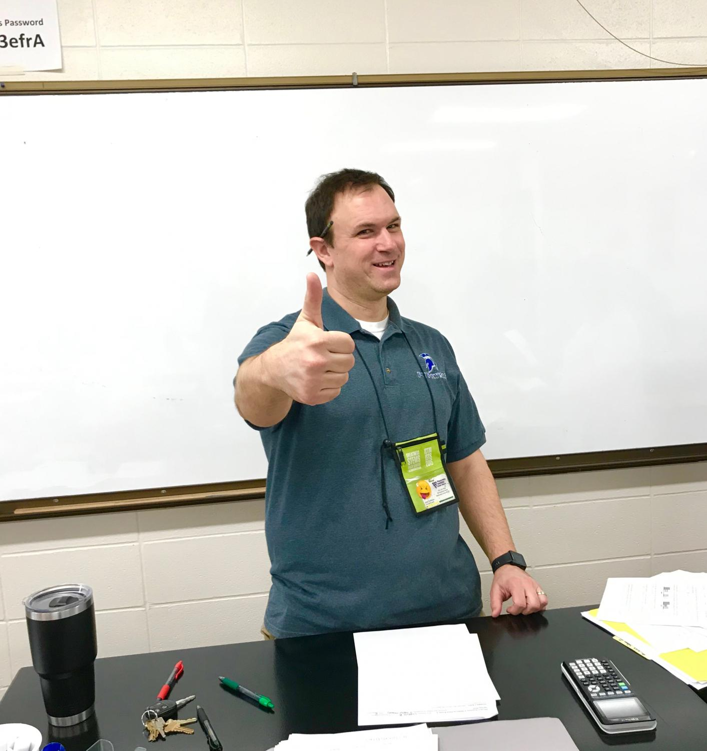 Mr. Hoffman giving a thumbs up after handing out his midterm final.