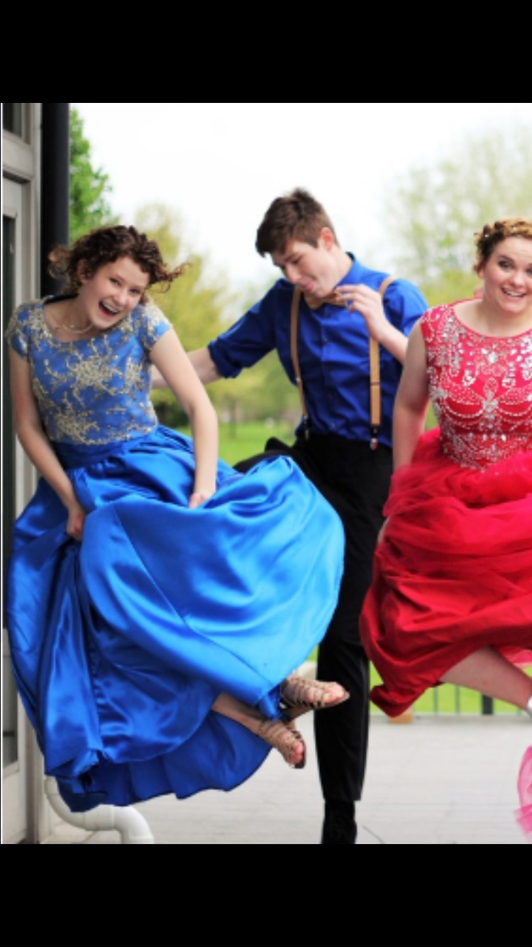 Stuent Emily Johnson jumps for joy in the prom dress she made