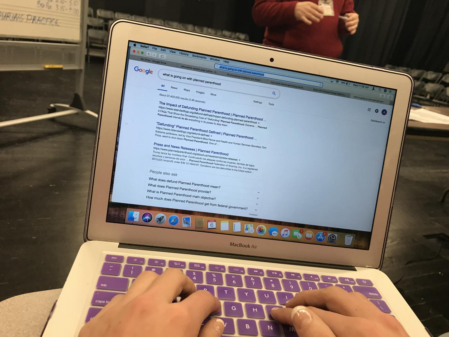 Senior student, Adrea Arthofer, looks at articles in question of what is happening to Planned Parenthood.