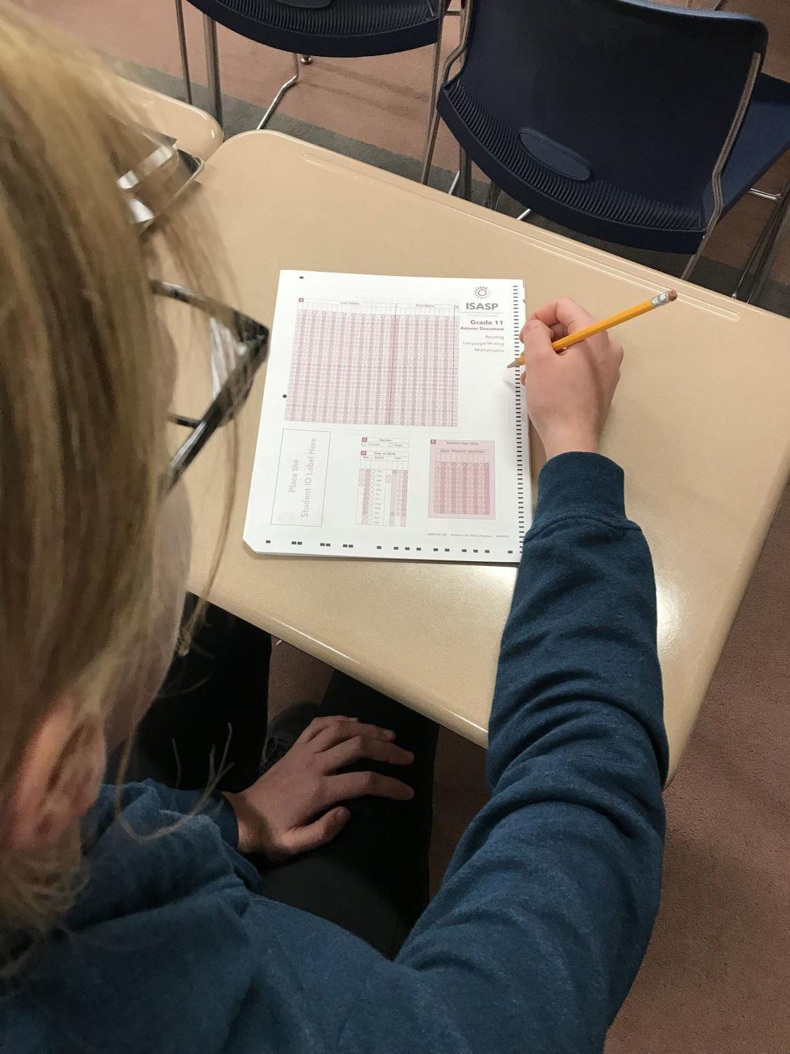 Natalie Cremer, a senior at PV, examines the new Iowa assessments known as the ISASP