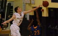 Joe Wieskamp blocks a shot during one of his high school basketball games.
