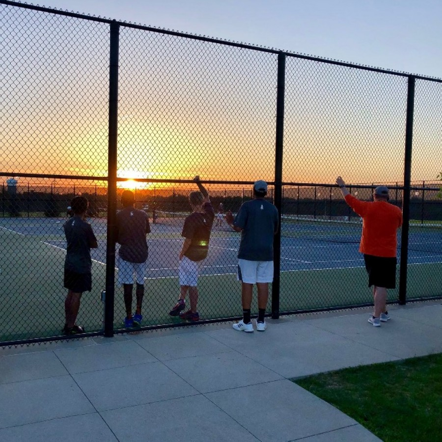 Players at the West Des Moines Valley vs. Pleasant Valley tennis meet on Monday, May 7 waiting for the meet to finish before a three hour drive home.